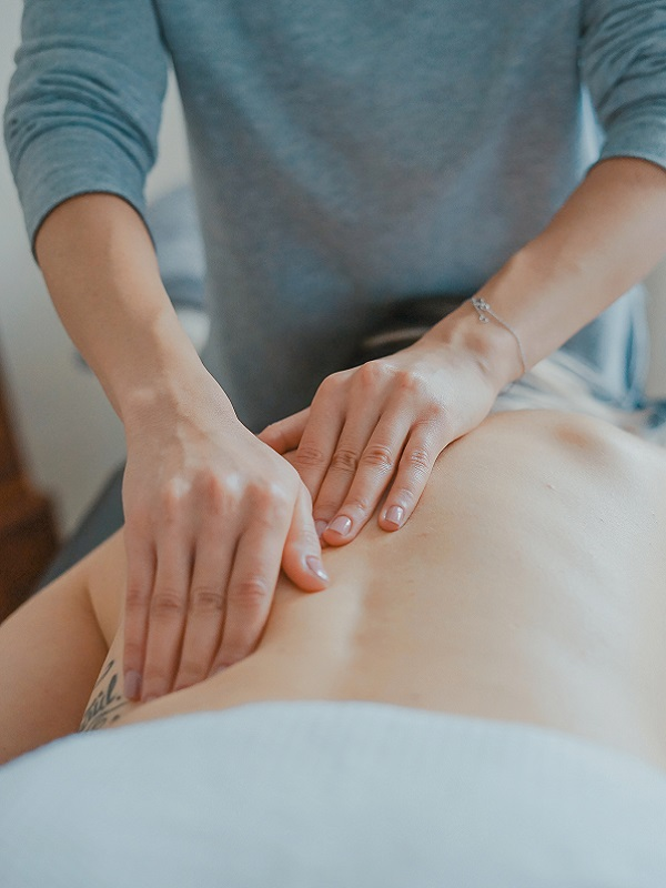 A photo of a woman getting her back rubbed, used for the Massage Therapy page on Core Kneads Therapeutics & Wellness in Truro, NS